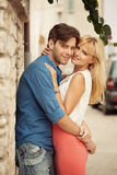 Young hugging couple on the holidays Stock Photography