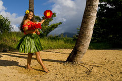 Young Hula dancer. Hawaiian teenage girl dancing Hula on the beach in Kauai