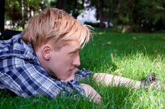 Young human on the green grass Royalty Free Stock Photo