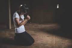 Young  human hands praying to god, Christian Religion concept background.  stock photo
