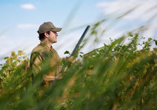 Young hunter camouflaged in dense vegetation Stock Image
