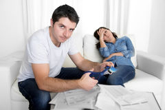 Young husband cutting credit card with scissors woman depressed Stock Image