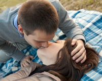 Young husband kisses her young bride Stock Images