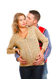 Young husband kissing his pregnant wife Stock Image