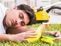 Young husband man cleaning floor at home. The young husband man cleaning floor at home stock images