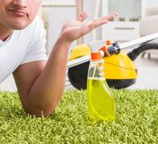 Young husband man cleaning floor at home. The young husband man cleaning floor at home royalty free stock images