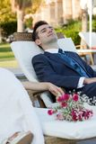 Young husband sitting with a happy smile Stock Images