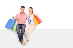 Young husband and wife holding shopping bags Royalty Free Stock Photo