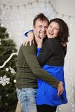 Young husband and wife laugh in Christmas decorate room Stock Image
