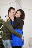 Young husband and wife laugh in Christmas decorate room Royalty Free Stock Photo