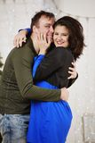 Young husband and wife laugh in Christmas decorate room Royalty Free Stock Photos
