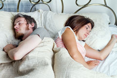 Young husband and wife sleeping on the bed in bedroom Royalty Free Stock Photography
