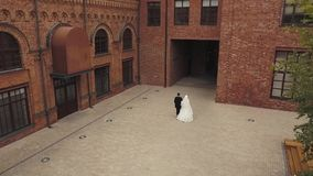 Young husband and wife on wedding day walking together back view stock footage