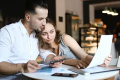 Young husband and wife working with documents. royalty free stock photography
