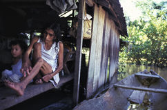 Young ill woman in the Amazon, Brazil. A leprosy patient in her wooden house in the Amazon. Labrea, State of Amazonas, Brazil Stock Photo