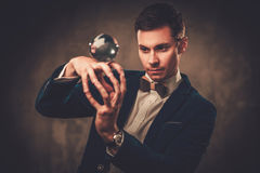 Young illusionist performing tricks on a stage Stock Image