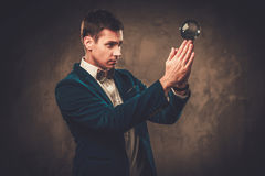 Young illusionist performing tricks on a stage Stock Photo