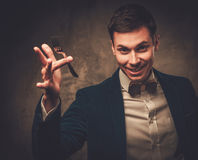 Young illusionist performing tricks on a stage Royalty Free Stock Images
