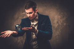 Young illusionist performing tricks on a stage Royalty Free Stock Photo