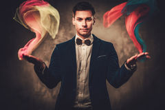 Young illusionist performing tricks on a stage Royalty Free Stock Photos