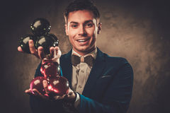 Young illusionist performing tricks on a stage Royalty Free Stock Photography