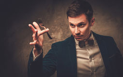 Young illusionist performing tricks on a stage Stock Photos