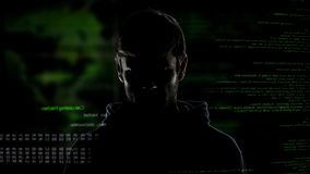 Young incognito man, internet hacker with numbers and code, cybercrime threat. Stock photo royalty free stock images
