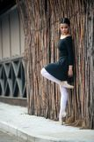 Young and incredibly beautiful ballerina is posing and dancing in a white studio full of light. stock photos