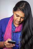 Young india woman with smartphone Royalty Free Stock Images