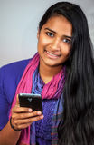 Young india woman with smartphone 6 Stock Photos