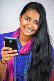 Young india woman with smartphone 5 Royalty Free Stock Image