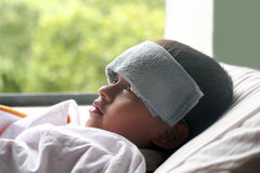 Young indian boy(child) down with fever & illness in hospital Royalty Free Stock Images