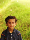 Young Indian boy in field Royalty Free Stock Image