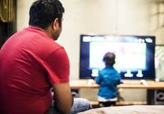 Young Indian boy watching television Royalty Free Stock Photo