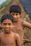 Young Indian boys in field. Young Indian boys muddy from playing in dirt royalty free stock image