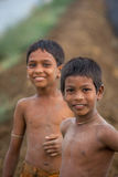 Young Indian boys in field. Young Indian boys muddy from playing in dirt royalty free stock photo