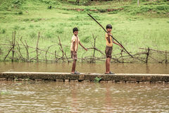 Young Indian boys in field. Young Indian boys muddy from playing in dirt royalty free stock photography