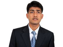 Young Indian business man. In puzzled pose Royalty Free Stock Images