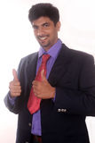 Young indian business man showing thumbs up gesture on white Royalty Free Stock Images