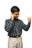 Young Indian business man using cellphone Stock Photo