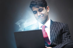 Young Indian Business Man using illuminated tablet Royalty Free Stock Photos