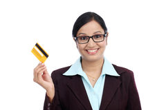 Young Indian business woman with credit card. Happy young Indian business woman with credit card against white background Stock Photography