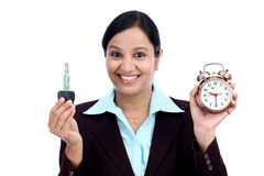 Young Indian business woman holding bulb Stock Photos