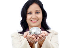 Young Indian business woman holding puzzle globe Stock Images
