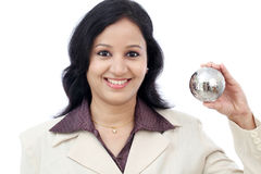 Young Indian business woman holding puzzle globe Royalty Free Stock Photos