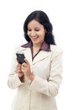 Young  Indian business woman text messaging Stock Photos