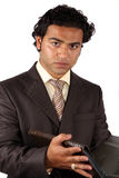 Young Indian Businessman. A portrait of a young Indian businessman, on white studio abckground Stock Photo
