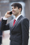 Young Indian businessman communicating on cell phone Royalty Free Stock Photography