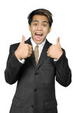 Young Indian businessman gives thumbs up. Young dynamic Indian businessman, yuppie type, intensely smiling, cheering and making the thumbs up gesture. Isolated Stock Photos
