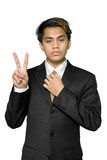 Young Indian businessman making V-sign Royalty Free Stock Image